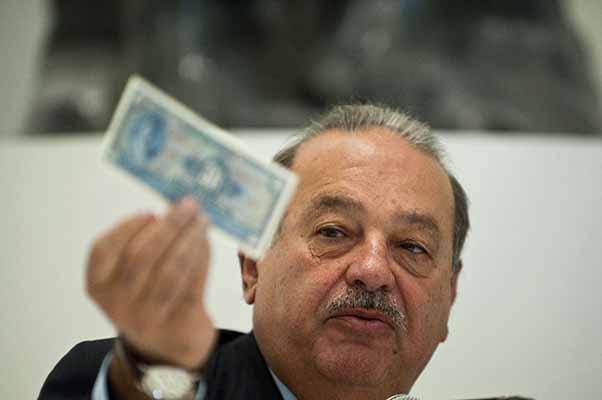 Mexican tycoon Carlos Slim speaks during