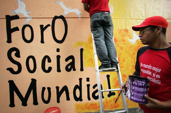 Activistas venezolanos pintan un mural con motivo del foro que se inaugura en Caracas hoy, 24 de enero FOTO Ap