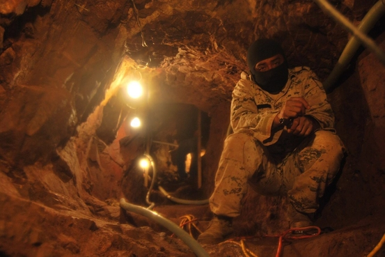 epa03530669 A soldier of the Mexican army walks in a tunnel found in Nogales, Mexico, 10 January 2013. The unfinished tunnel has 56 meters long, three levels and water and air sources.  EPA/-