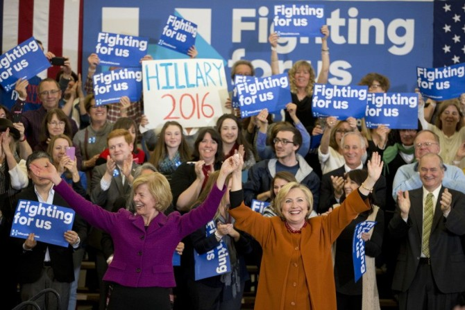 Democratic presidential candidate Hillary Clinton, right, is joined by Sen. Tammy Baldwin, D-WI, left, at a campaign event, Saturday, April 2, 2016, in Eau Claire, Wis. (AP Photo/Mary Altaffer)