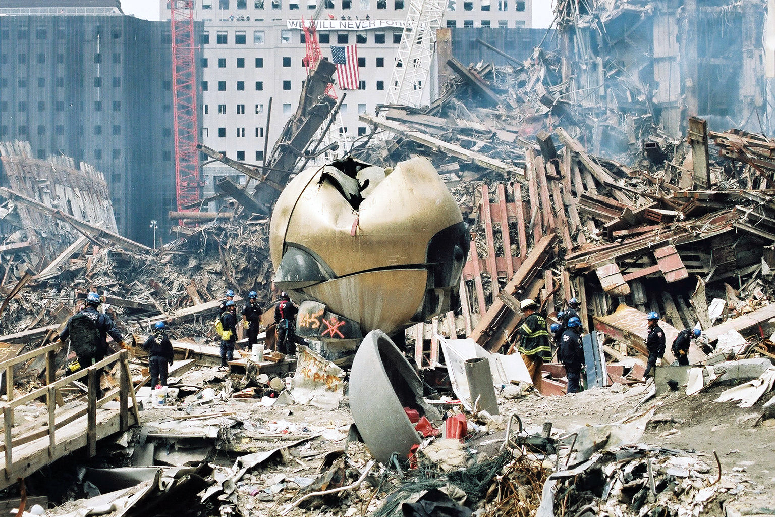 New York, NY, September 27, 2001 -- Rescue crews work to clear debris from the site of the World Trade Center. Photo by Bri Rodriguez/ FEMA News Photo