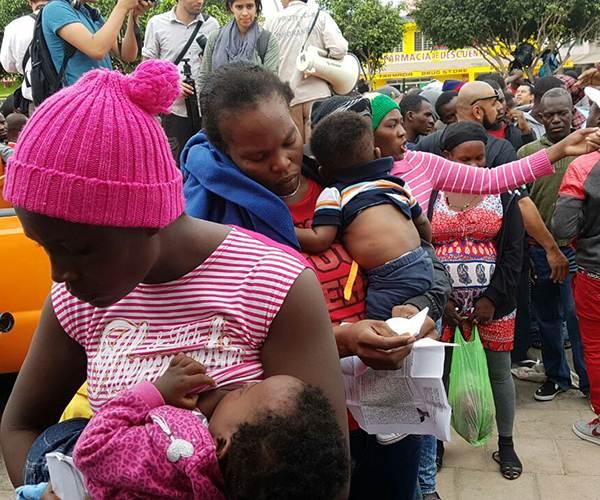 haitianos-mujere-bebe