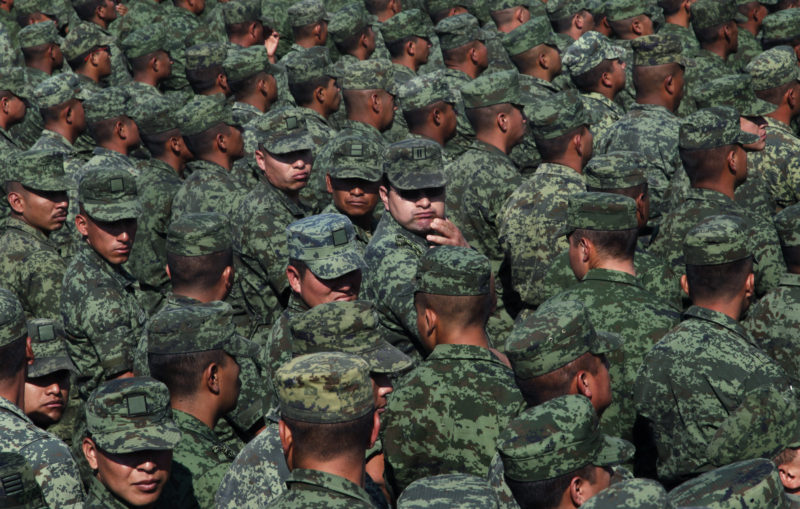 Soldiers attend an event with Mexico's Defense Secretary Gen. Salvador Cienfuegos Zepeda at the Number 1 military camp in Mexico City, Saturday, April 16, 2016. Cienfuegos formally apologized to the country for a video-recorded incident of torture involving two soldiers and a federal police officer. He urged soldiers and citizens to come forward to report other abuses. (AP Photo/Marco Ugarte)